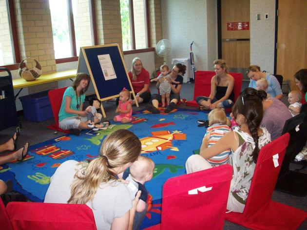 Story time class playing with babies